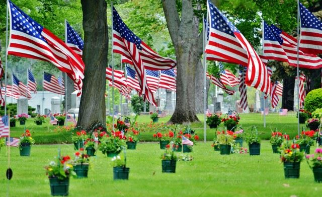 stock-photo-usa-cemetery-american-flag-flowers-flags-honor-urns-veterans-memorial-day-3617232e-78b7-